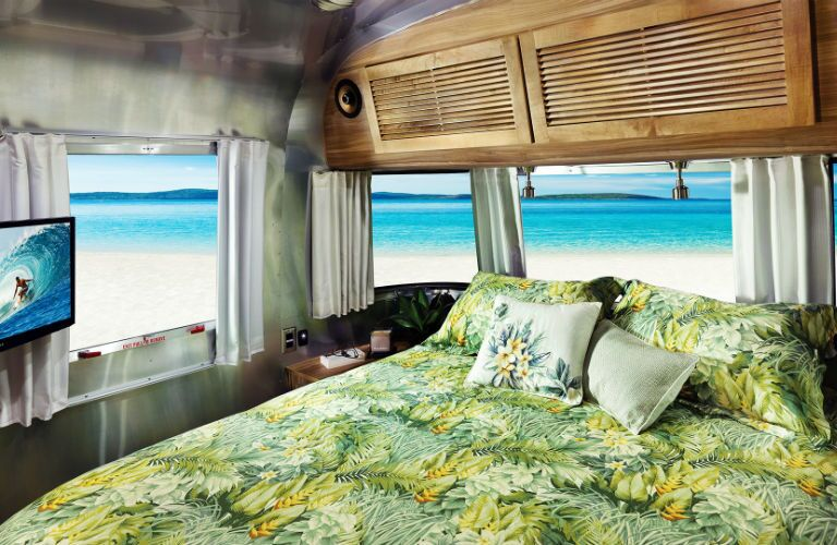 A photo of the master bedroom in the 2019 Airstream Tommy Bahama.