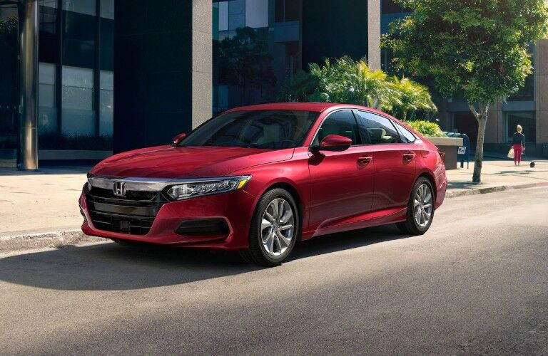 Front driver angle of a red 2020 Honda Accord parked on the side of a street