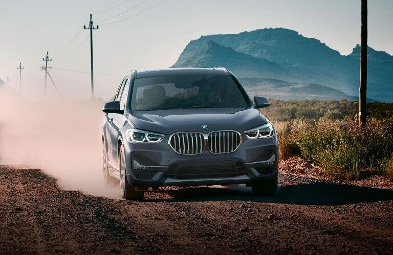 2020 BMW X1 driving down dirt road