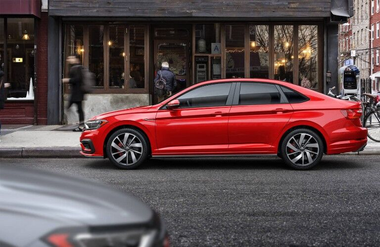 Driver angle of a red 2019 Volkswagen Jetta GLI parked on the side of a street