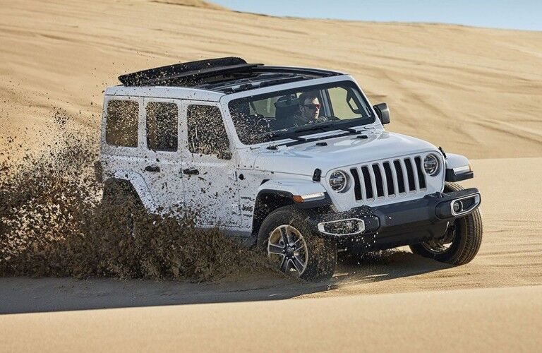 2019 Jeep Wrangler driving on sand