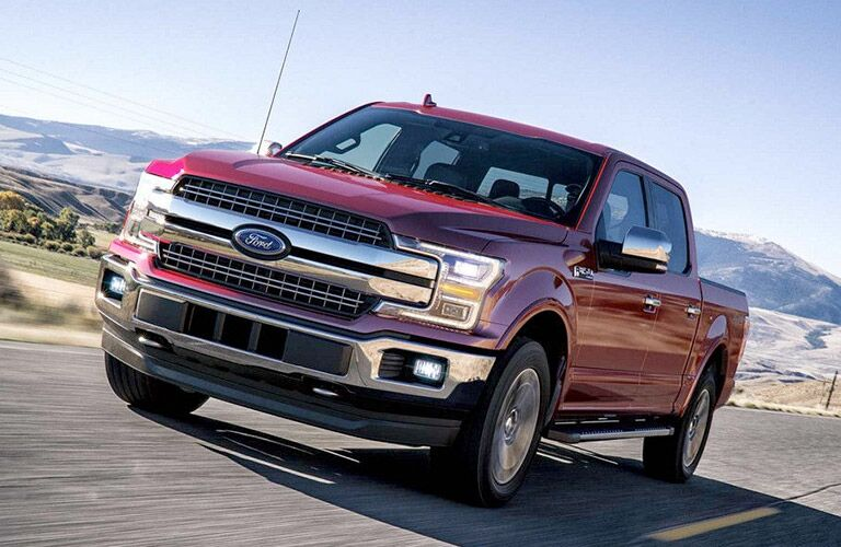 Front view of red 2018 Ford F-150 Lariat on the road