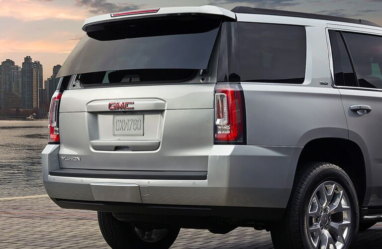 2020 GMC Yukon back end with big city skyline in the background