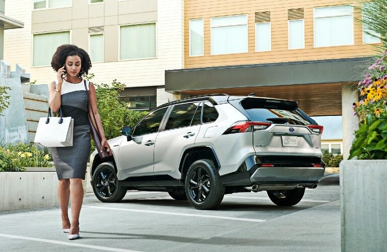 2021 Toyota RAV4 Hybrid with woman walking toward camera