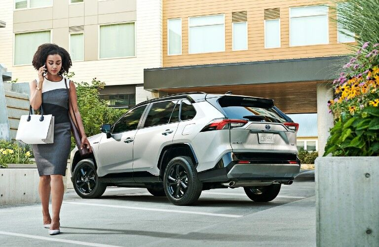 2021 Toyota RAV4 with woman walking away from it