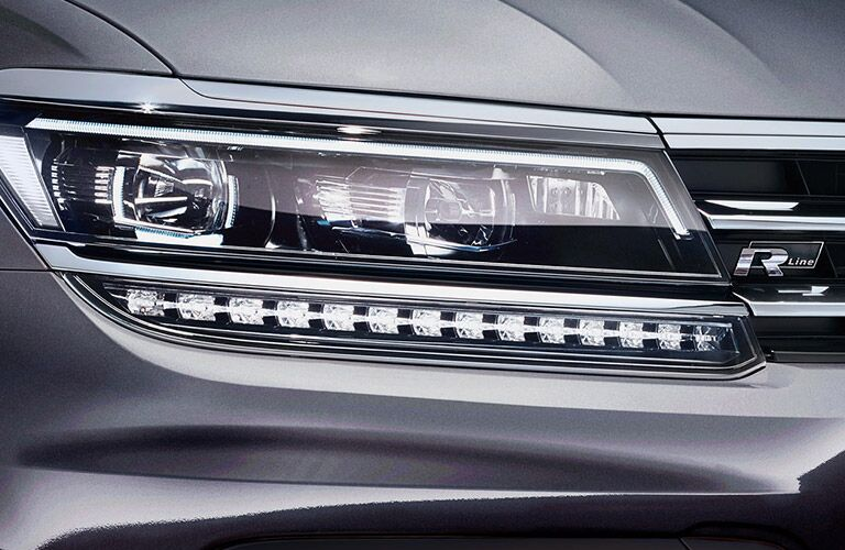 The front headlights on a gray 2021 Volkswagen Tiguan.