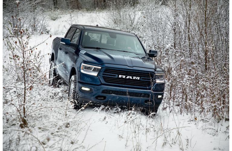 2021 RAM 1500 going down a snowy mountain
