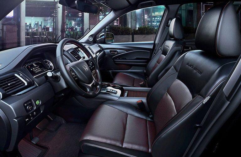 Front seats inside of the 2021 Honda Pilot