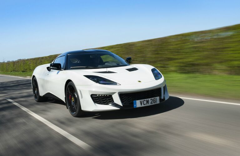 white lotus evora on a country road