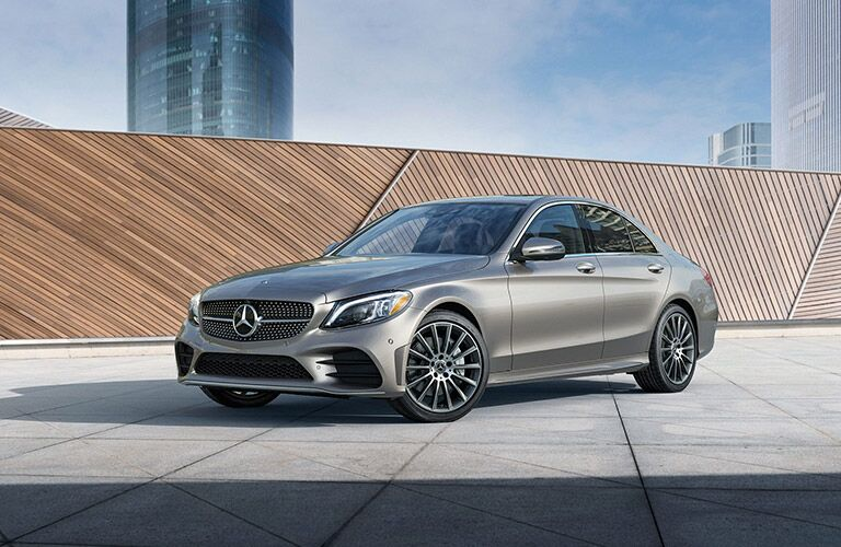 2020 MB C-Class exterior front fascia driver side in front of wooden wall in city