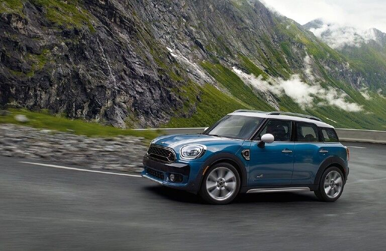 blue Mini vehicle by a mountain