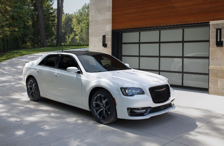 2021 Chrysler 300 parked in front of a garage