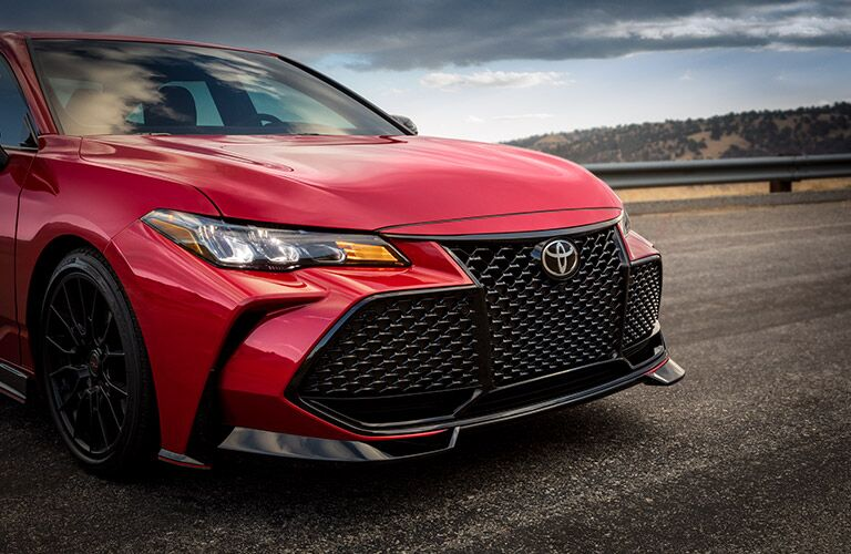 The front grille of a red 2020 Toyota Avalon.
