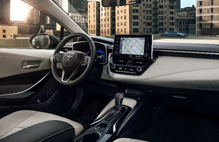 Interior view of 2020 Toyota Corolla with center touchscreen in frame