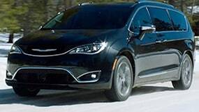 Blue Chrysler Pacifica driving in the snow