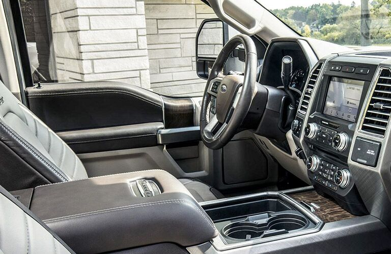 2018 Ford F-150 Lariat cabin with front seats, steering wheel and touchscreen view