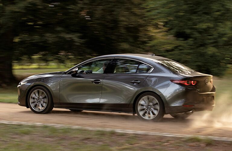 2020 Mazda3 Sedan driving on dirt road