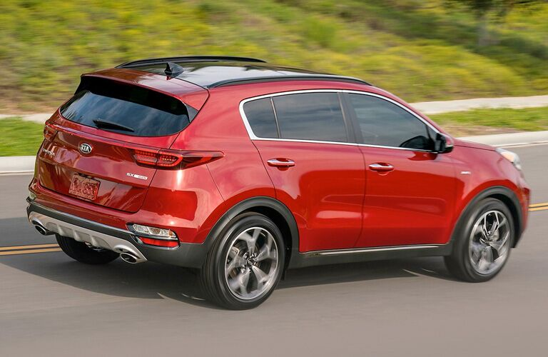 Exterior view of the rear of a red 2021 Kia Sportage