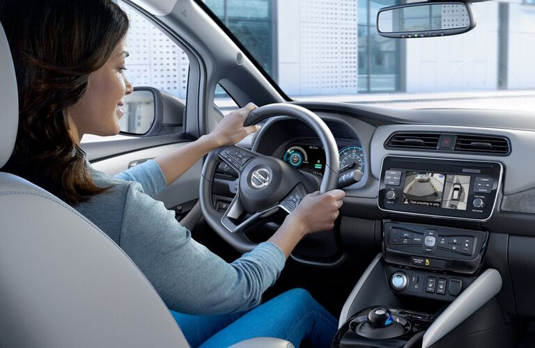 2020 Nissan Leaf with a woman driving and using the Around View monitor