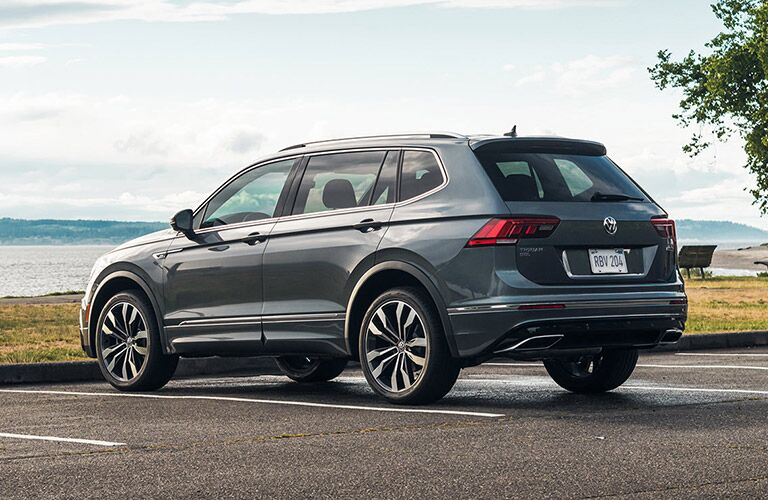 The 2021 Volkswagen Tiguan parked in a parking lot with a body of water in the background