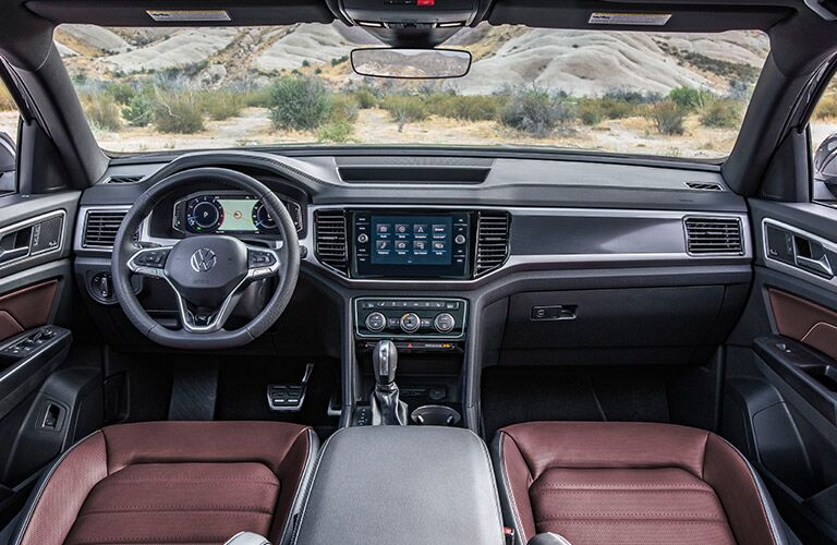 Interior view of the front seating area inside a 2020 Volkswagen Atlas Cross Sport