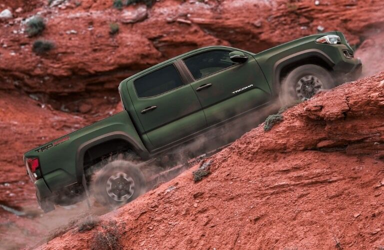 2021 Toyota Tacoma going up a dirt hill