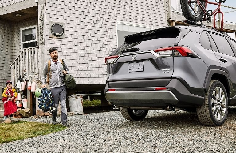 2021 Toyota RAV4 with father and son approaching to load cargo
