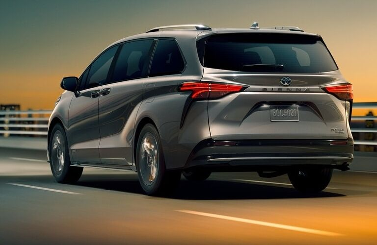 2021 Toyota Sienna driving away over a bridge