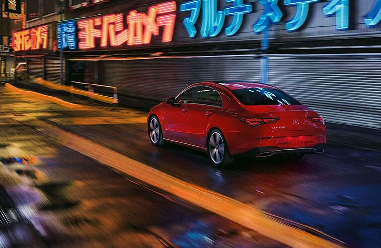 2020 MB CLA Coupe exterior rear fascia driver side in city at night with neon lights
