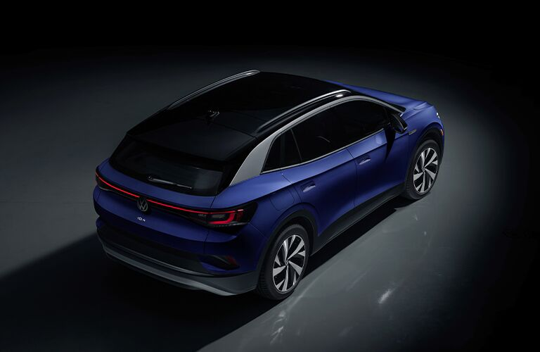 The top and side view of a dark blue 2021 Volkswagen ID.4.