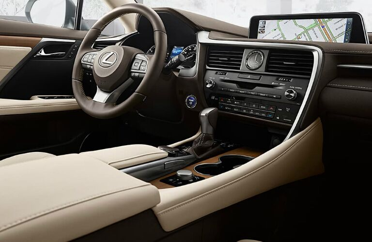 Interior front center console, infotainment, and steering region of a 2019 Lexus RX L.