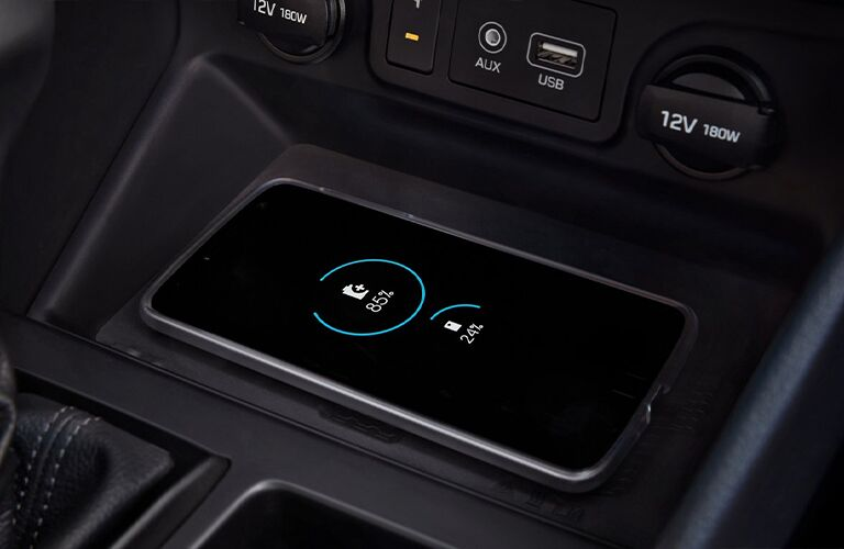 2021 Hyundai Tucson interior close up of phone charging wirelessly