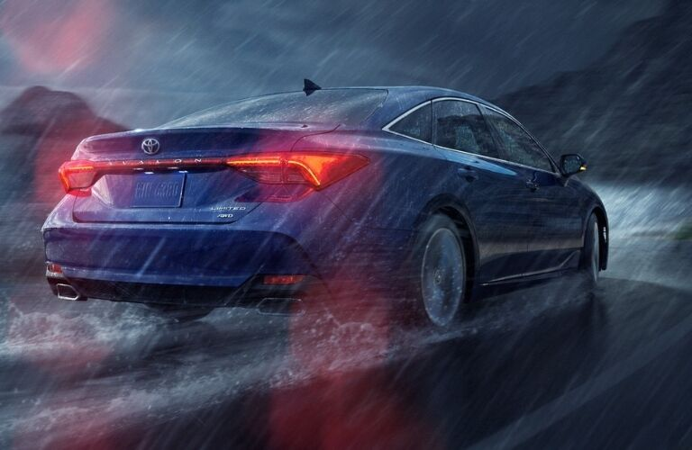 2021 Toyota Avalon driving away in the rain