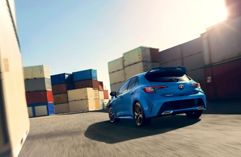 2020 Toyota Corolla Hatchback driving through cargo shipment