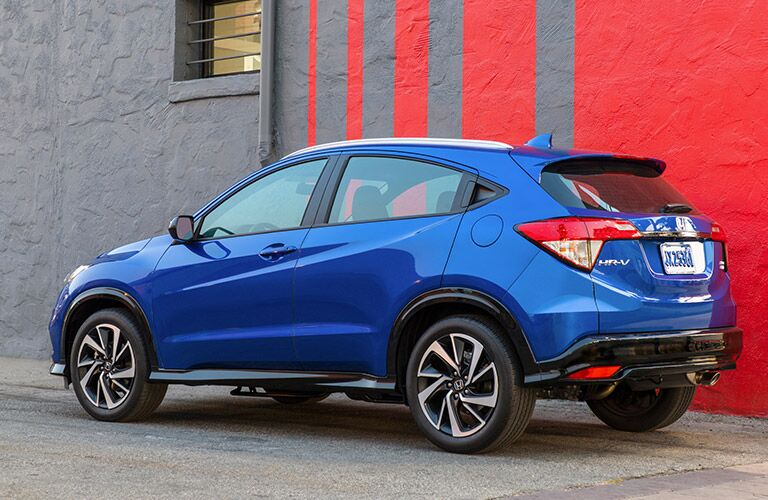 2019 Honda HR-V blue against a red and gray wall