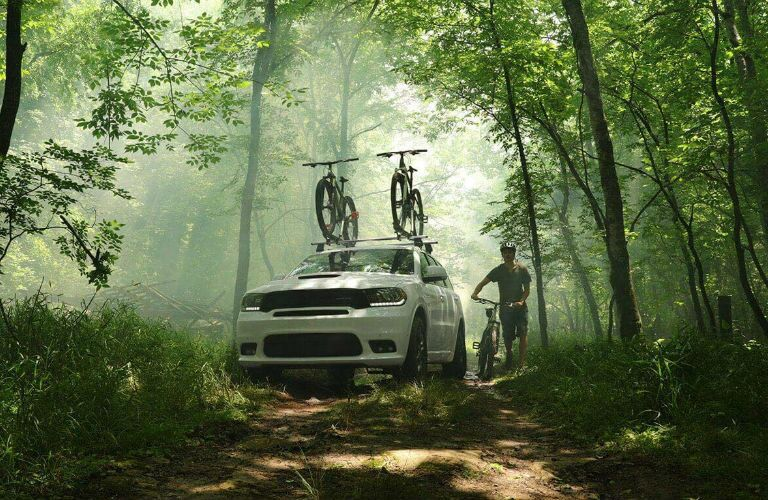 A photo of the 2020 Dodge Durango parked in the woods.