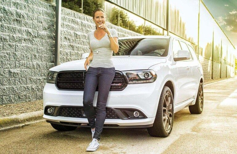 2020 Dodge Durango white front view with a girl in front