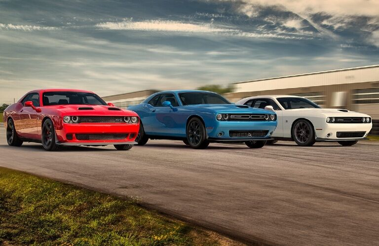 Three 2020 Dodge Challenger cars going down the road