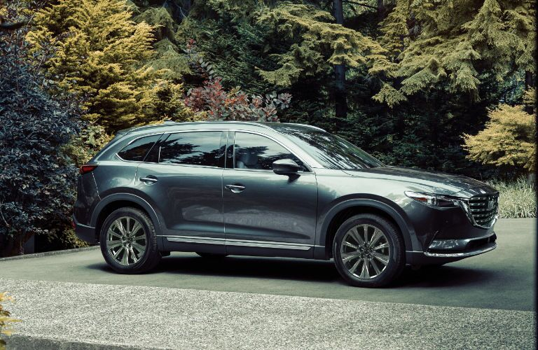 The front and side view of a gray 2021 Mazda CX-9.