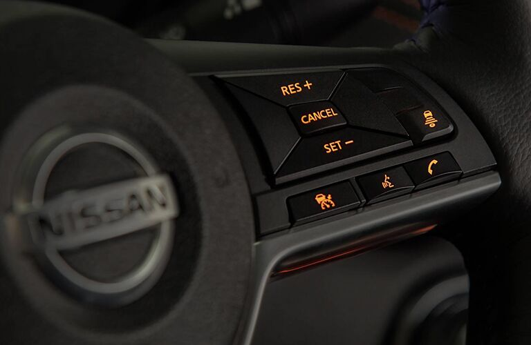 Interior view of the controls on the steering wheel inside a 2020 Nissan Sentra