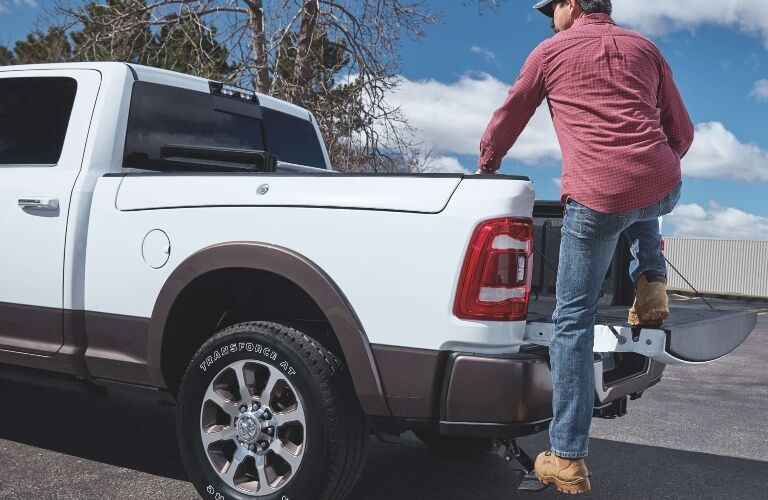 2020 RAM 2500 with man getting into back using tailgate