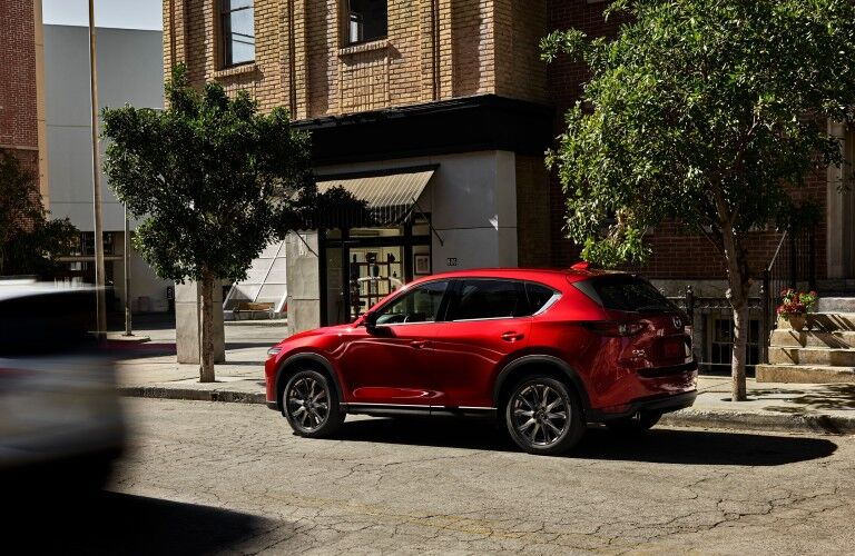 rear view of red 2021 Mazda CX-5 parked