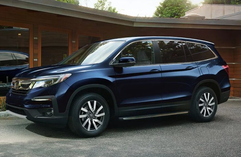 2020 Honda Pilot parked in front of a log cabin