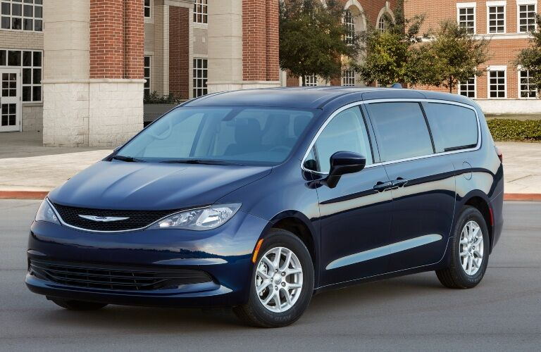 2020 Chrysler Voyager parked in front of brick building