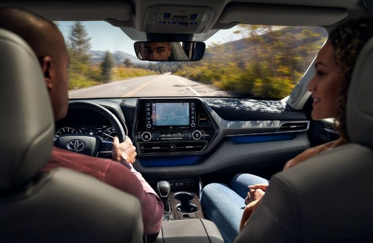 Two people in the front seats of the 2020 Toyota Highlander