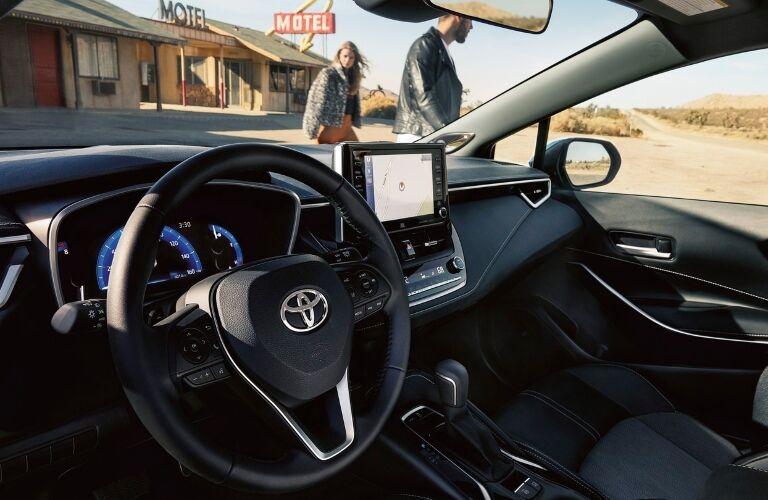 2020 Toyota Corolla Hatchback Dashboard with people that can be seen through the windshield