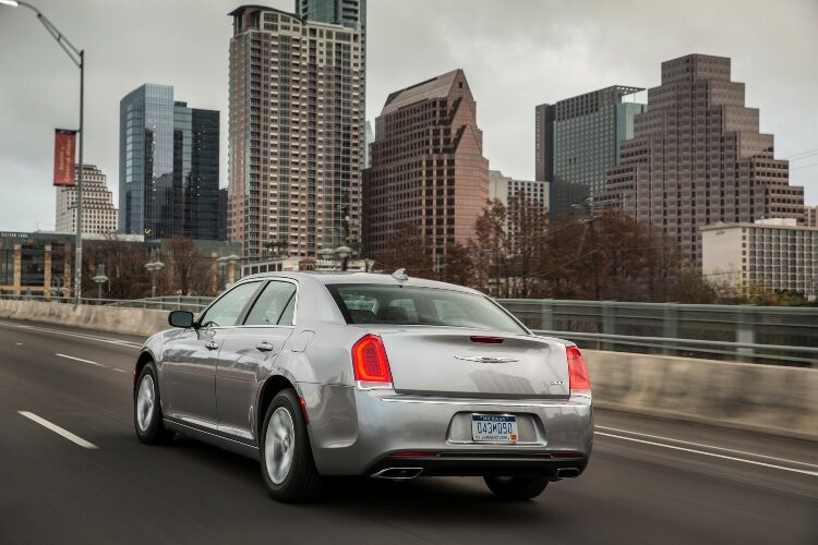 2019 Chrysler 300 with big city buildings in background