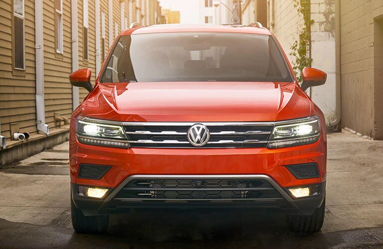 Front grille and headlights of orange VW Tiguan