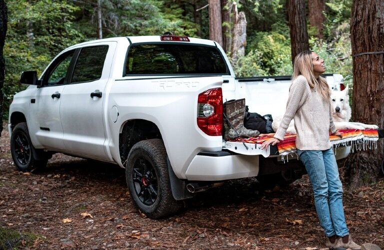 Woman and dog by rear of 2021 Tundra