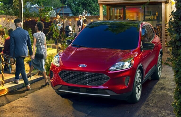 2020 Ford Escape parked next to a restaurant